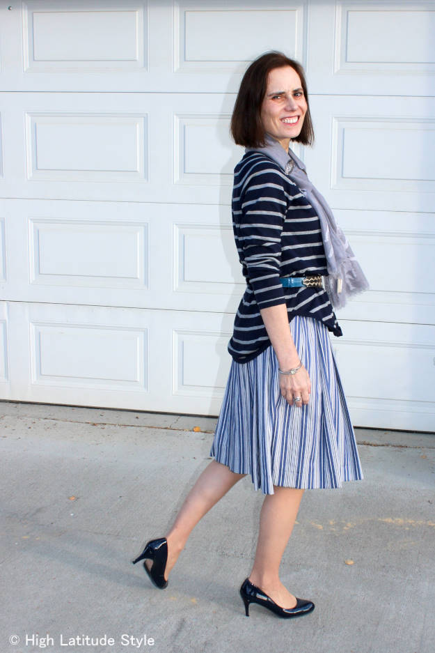 #fallfashion mature woman wearing a summer dress with sweater as a skirt for fall