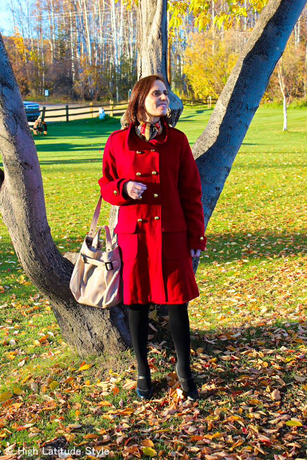 #styleover50 mature woman in red pea coat