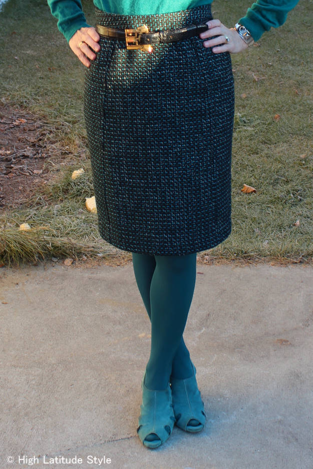 mature fashion woman in tweed skirt and sweater