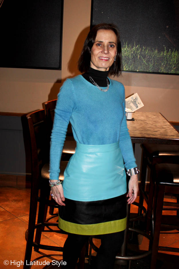 mature woman in color blocked leather skirt