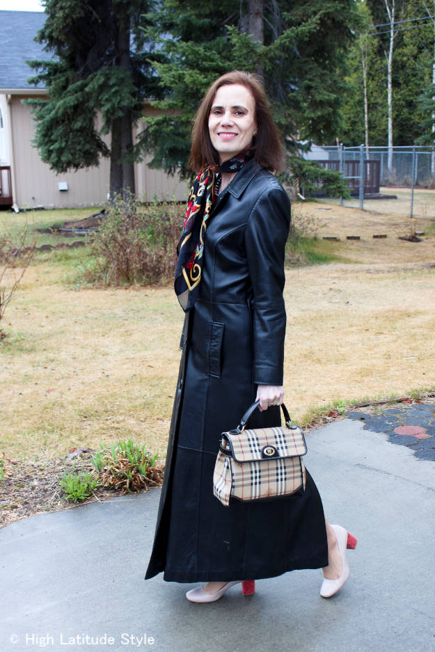 Fashion over 50 woman in long leather coat