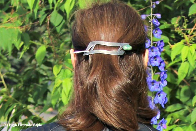 midlife woman wearing a half updo with barrette