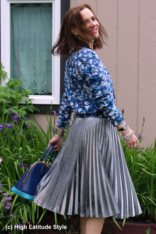 #fashionover40 mature woman in silver pleated skirt with floral blazer at