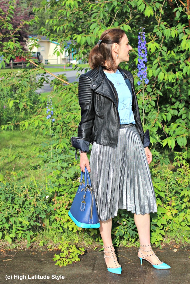 #fashionover50 mature woman wearing a silver pleated skirt