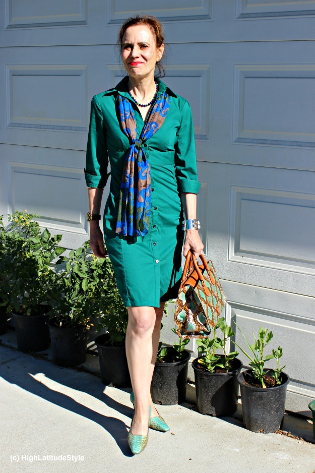 #styleover50 mature woman in a sleek shirt dress with scarf