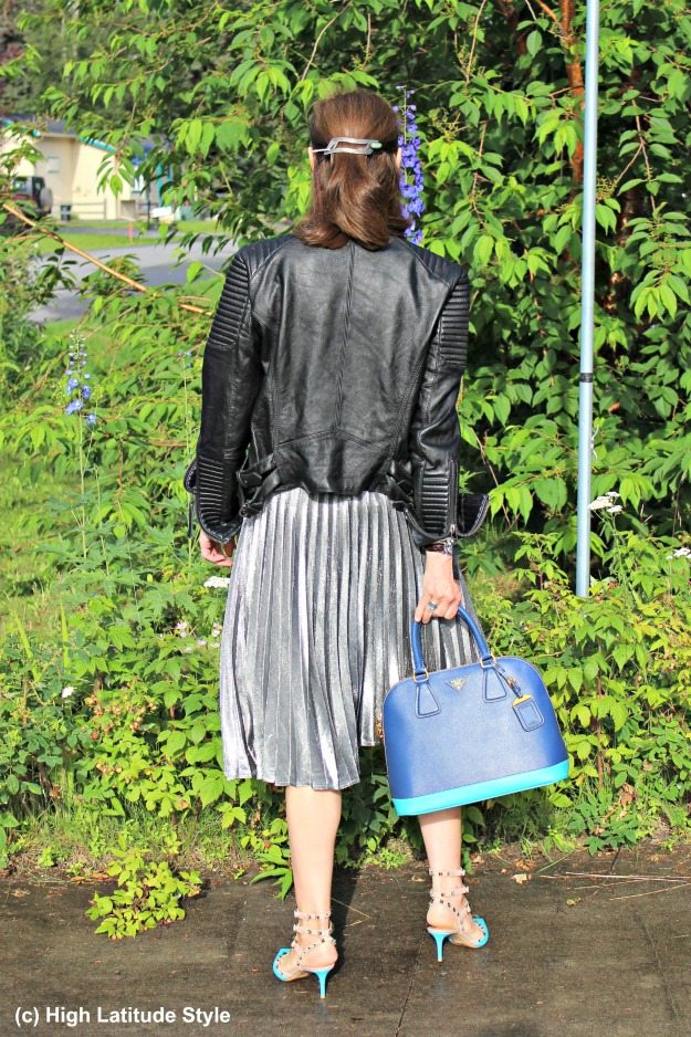 streetstyleover40 mature woman in pleated skirt with leather jacket