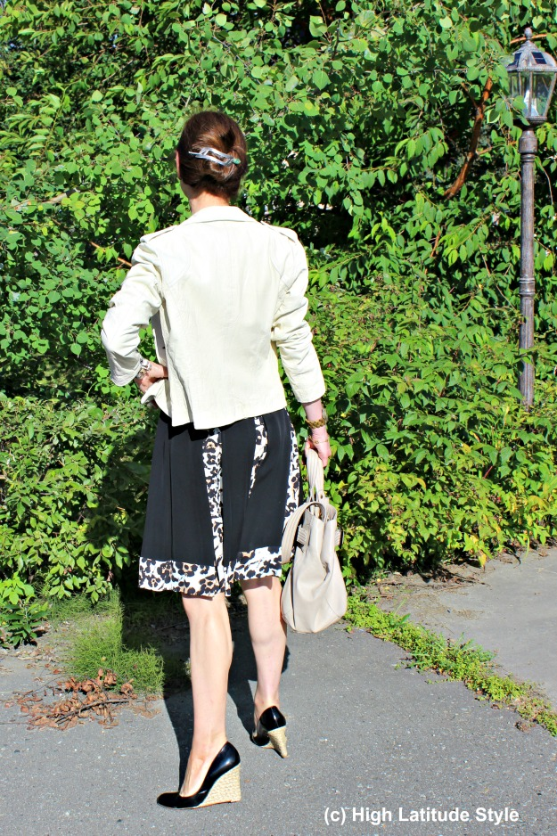 #styleover50 mature woman in dress and leather jacket back view