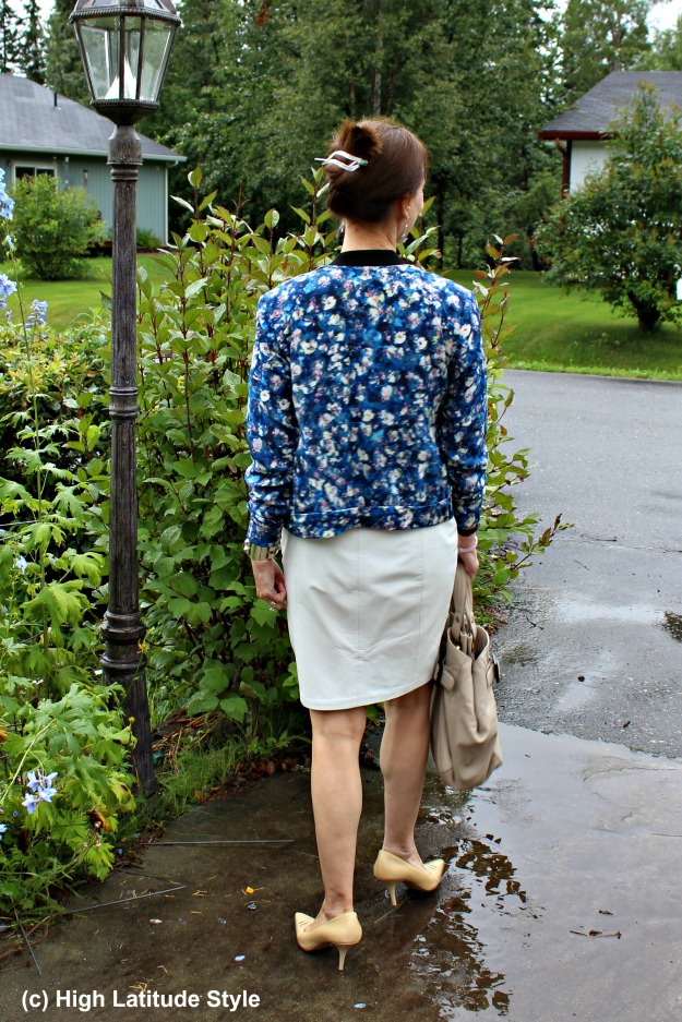 #styleover50 mature woman in floral bomber and white pencil skirt