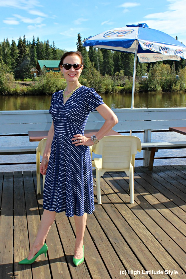 fashionover40 mature woman in classic navy-white polka dress for work