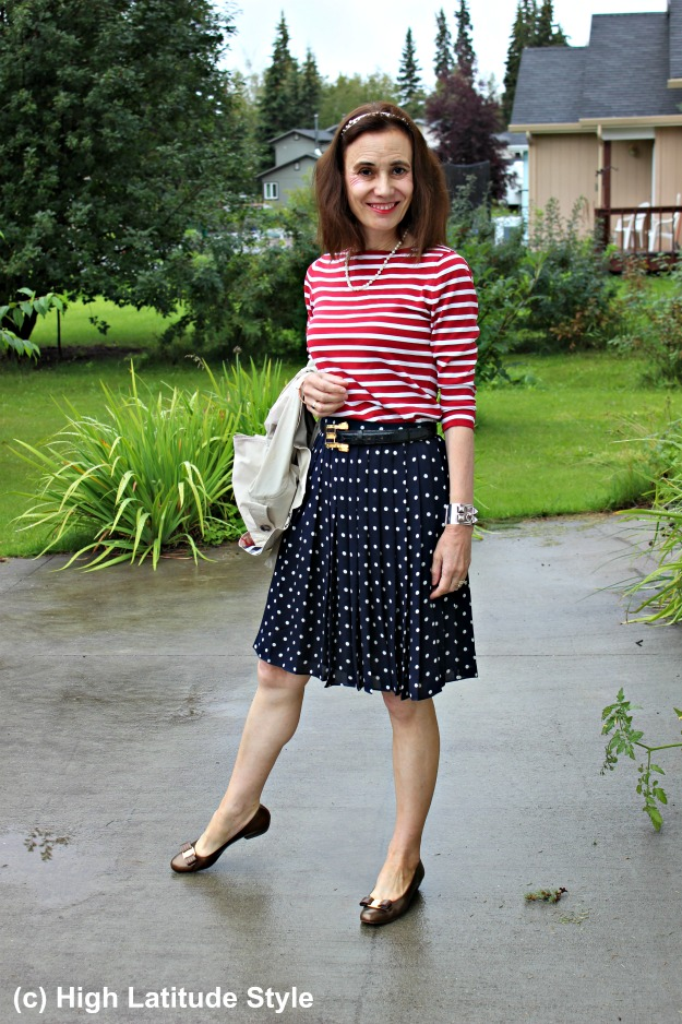 #fashionover40 mature woman in polka dot skirt and striped top
