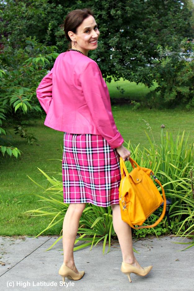 #fashionover40 mature woman wearing pink and doning a yellow bag