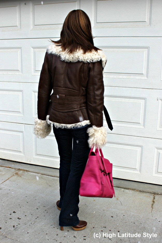 midlife style woman in shearling motorcycle jacket and flared jeans