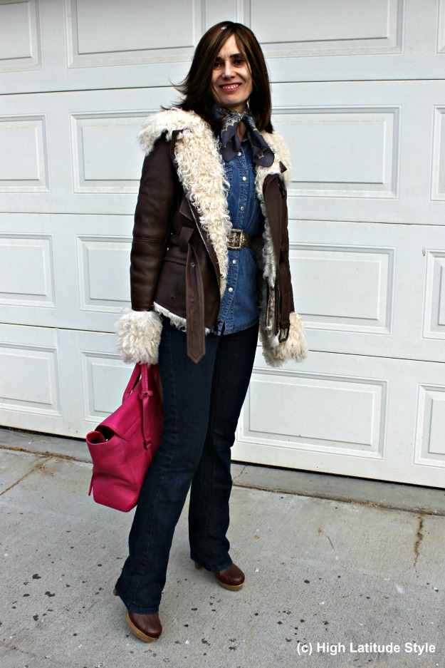 mature style woman in outerwear with shearling motorcycle jacket