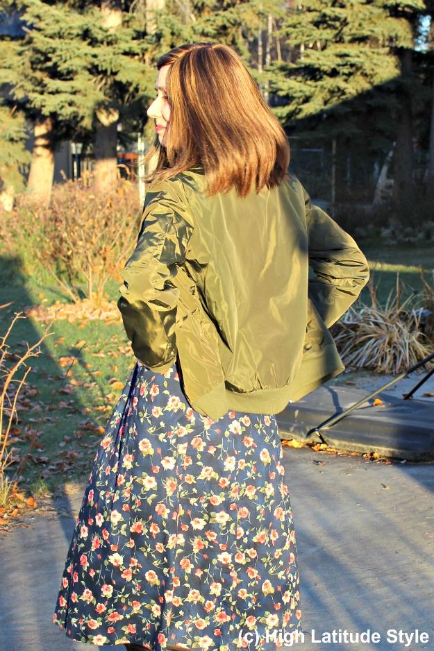 #fashionover50 bomber jacket over floral print dress