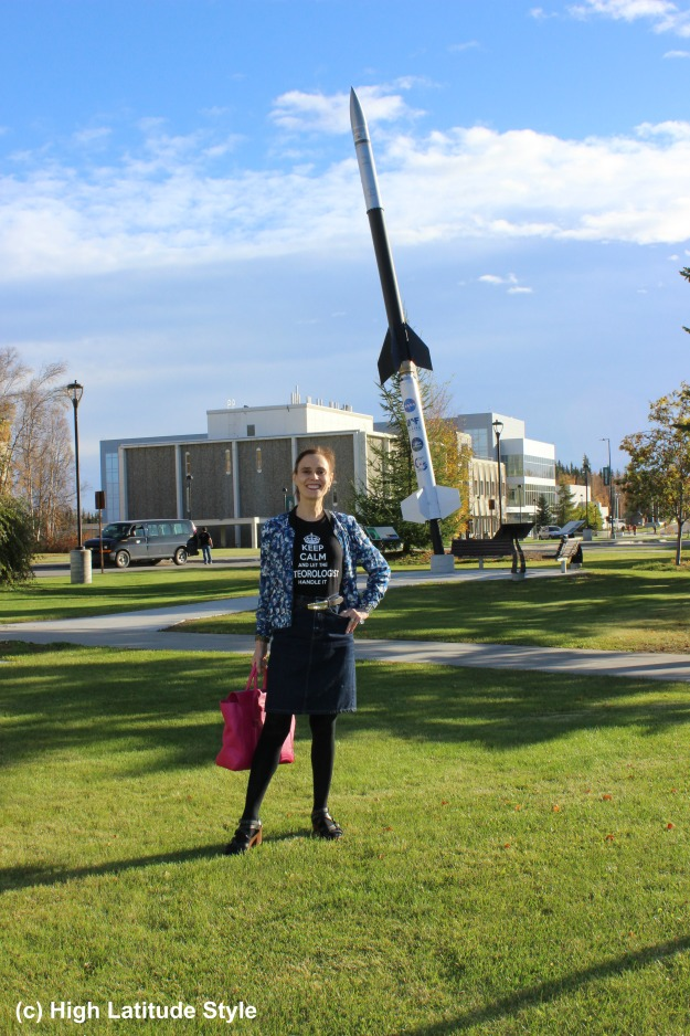 #fashionover40 mature woman standing in front of a rocket