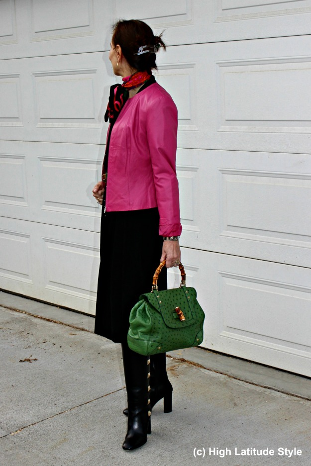 #fashionover40 woman in leather jacket with Gucci bag