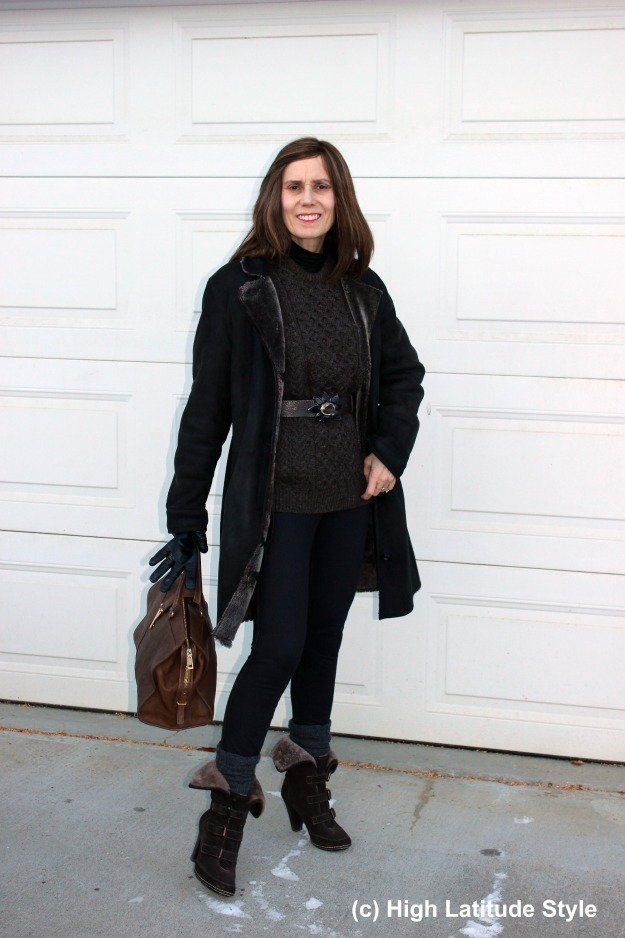 midlife woman in denim leggings, shearling and cable-knit sweater casual winter look