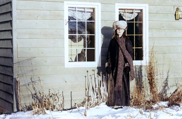 #styleover40 woman in long winter coat with hat and long scarf in Alaska