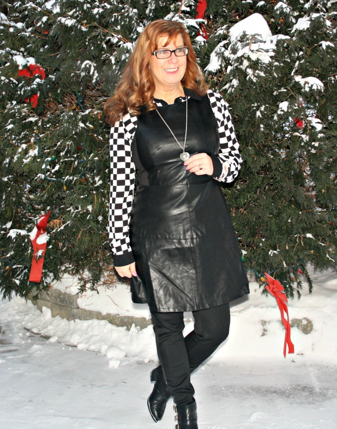 #styleover50 woman in black and white outfit with leather dress