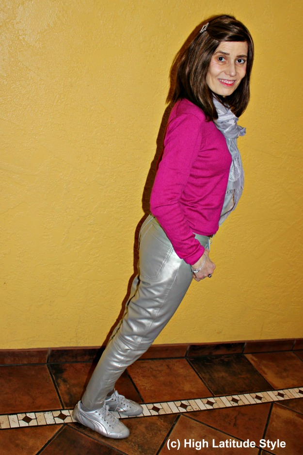 fashion over 40 woman wearing shiny leather pants with a pop of color