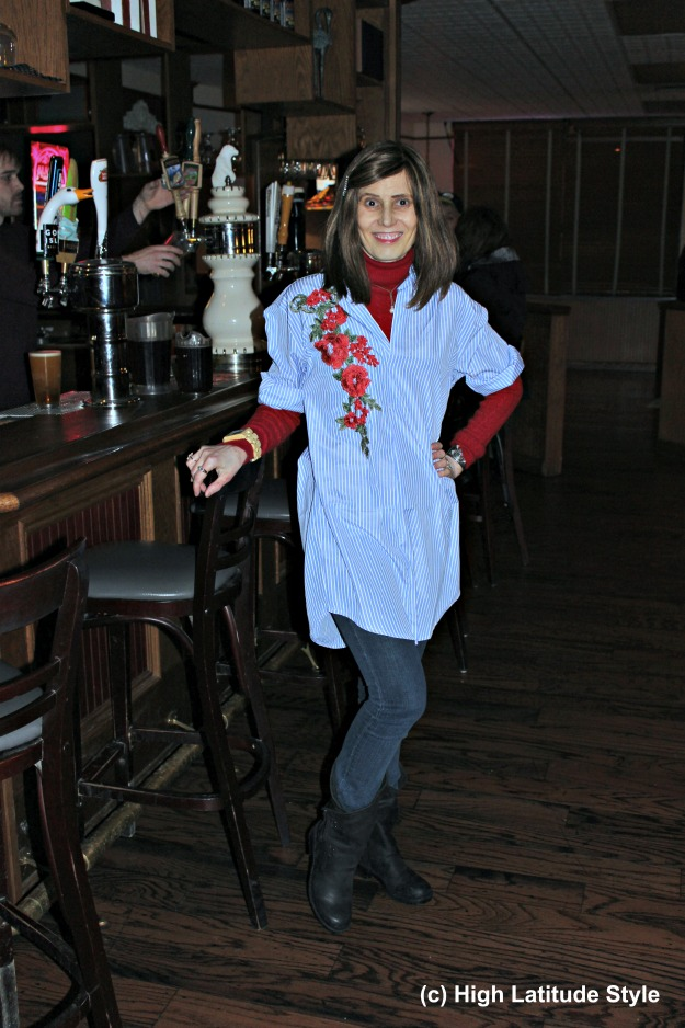 #Fashionover40 woman in embroidered shirt over turtleneck and skinnies