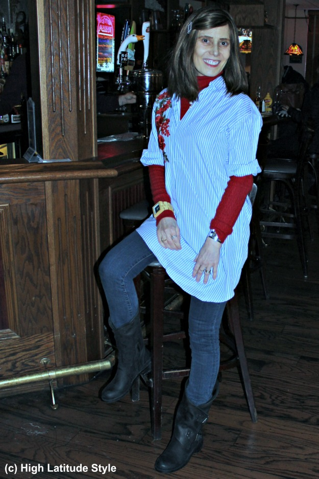 fashion over 40 woman wearing a long shirt and jeans