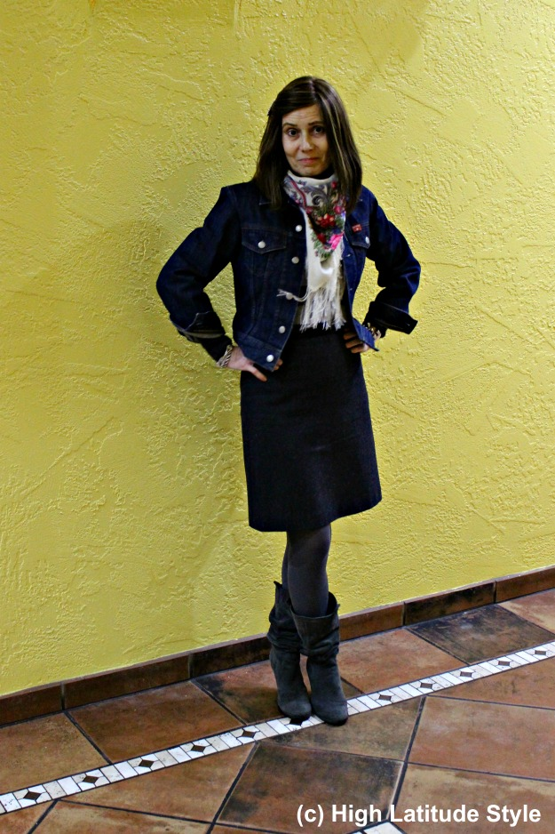 fashion over 50 woman in winter work outfit with tweed skirt and denim jacket