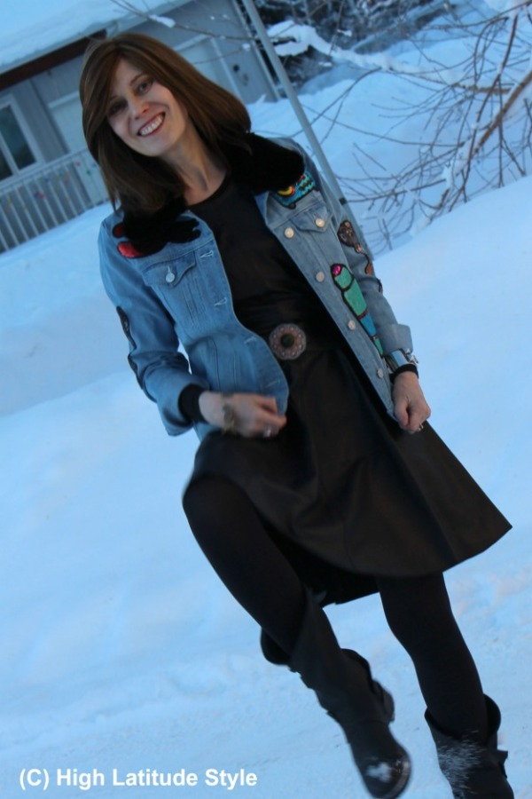 maturefashion woman in denim jacket with fit-and-flare leather dress