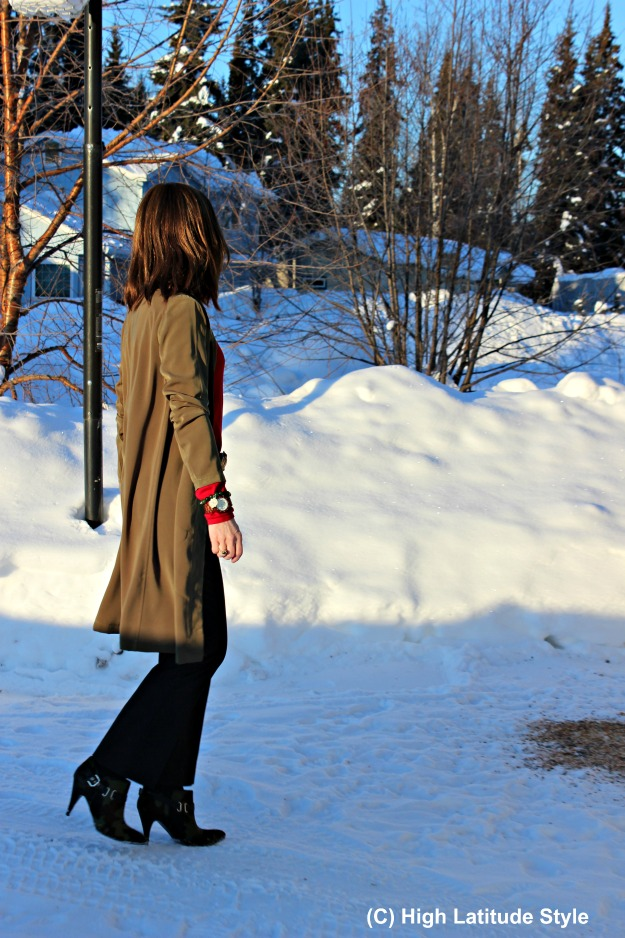 advanced style woman in overcoat and pants