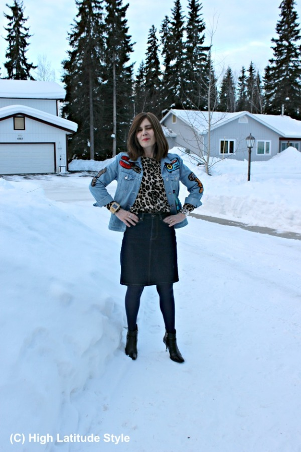 Fasion over 40 woman with leopard print, sequins and denim in one outfit