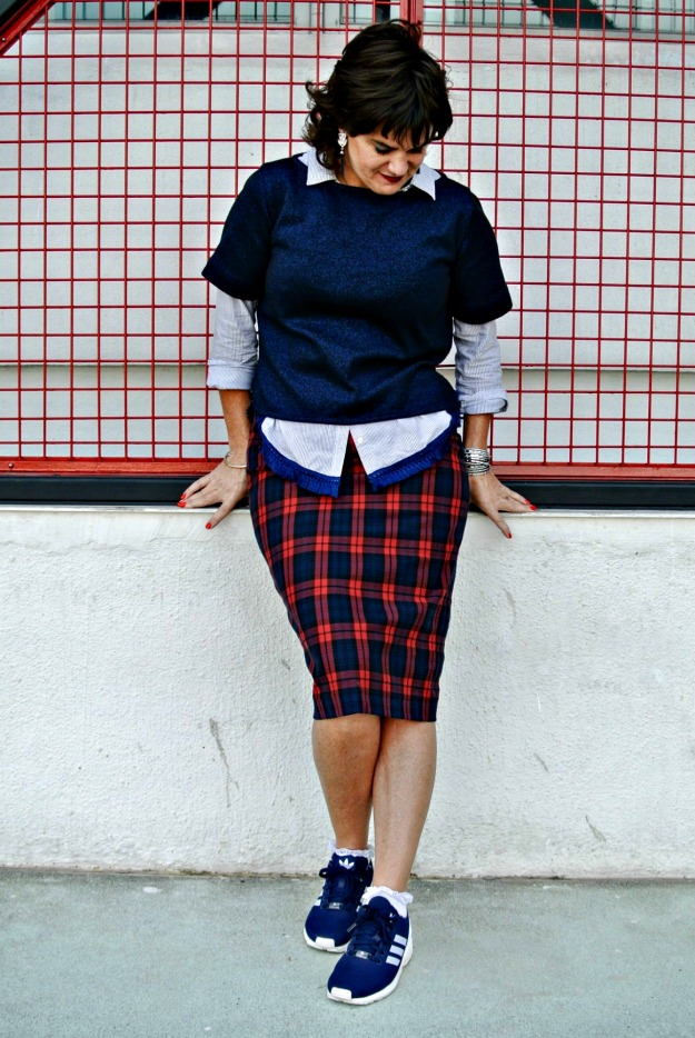 midlife streetstyle sneakers with midi skirt are a do