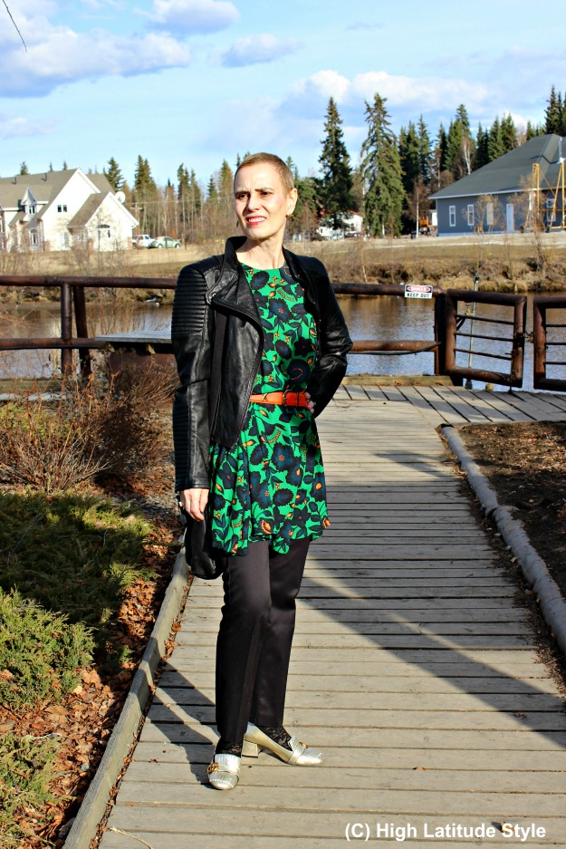fashionover40 woman in floral dress with black pants