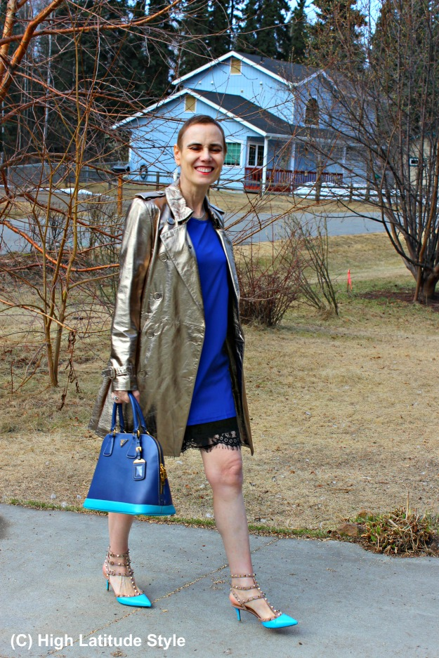 woman in golden leather trench and royal blue dress