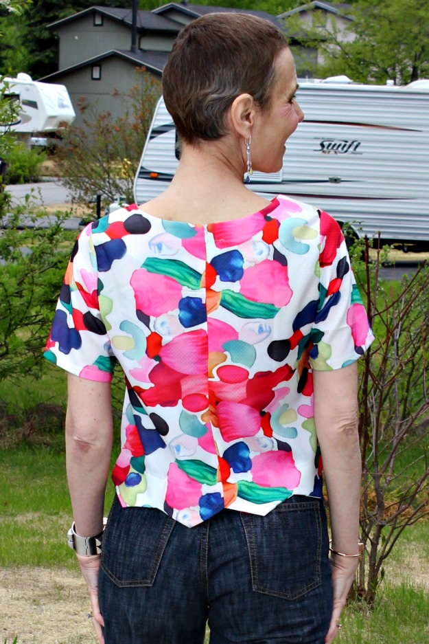 style over 50 woman in cropped floral print top