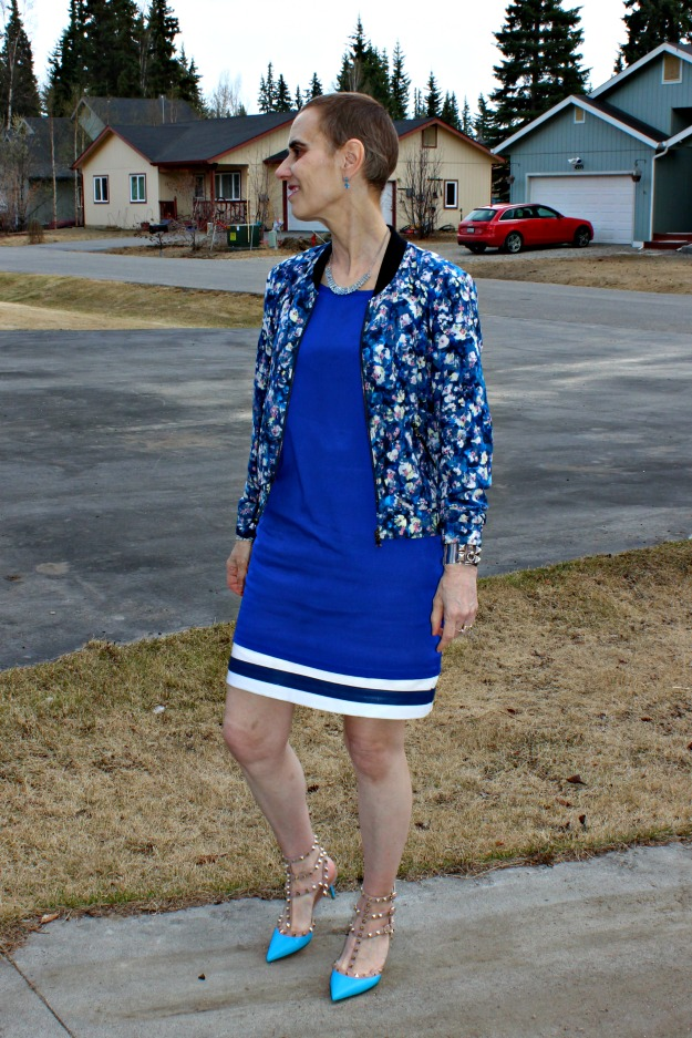 mature fashion woman in floral bomber