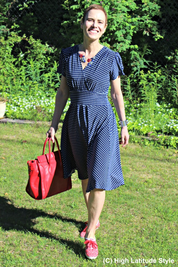 mature style woman in dress with Keds