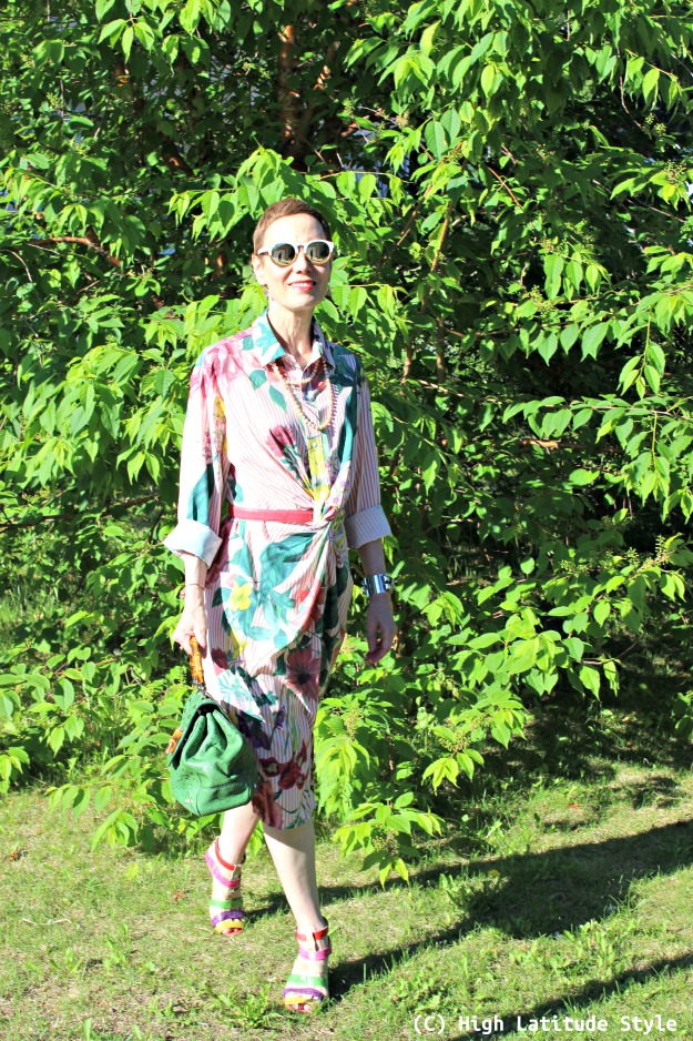 style over 50 woman in shirt dress with pink and green