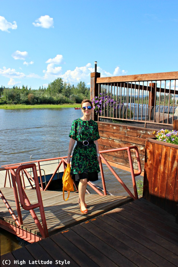 fashion over 40 woman in dress over skirt on boat mooring