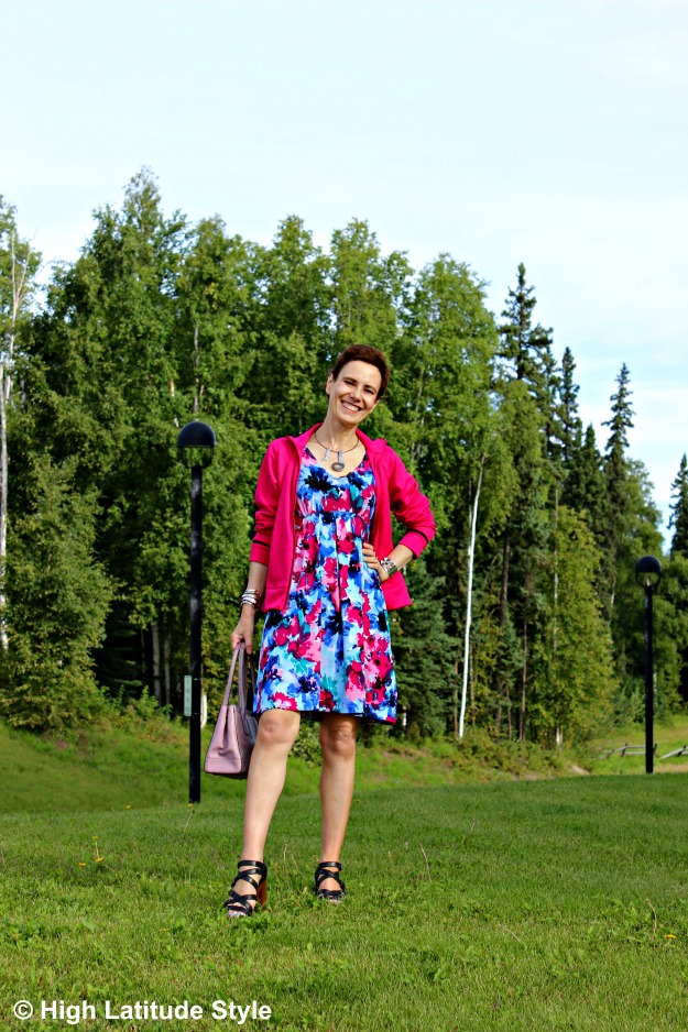 mature fashion woman in print dress and Adidas jacket