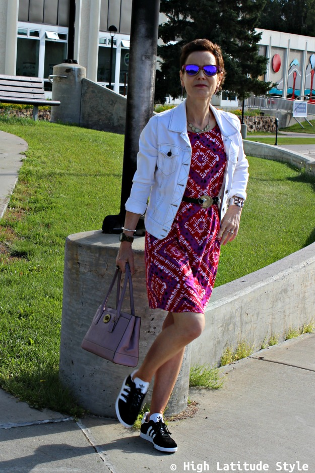 fashion over 50 woman in print dress with sneakers