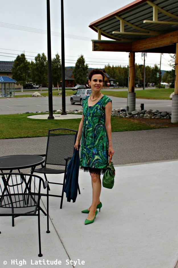 fashion over 40 woman in green print dress with cardigan