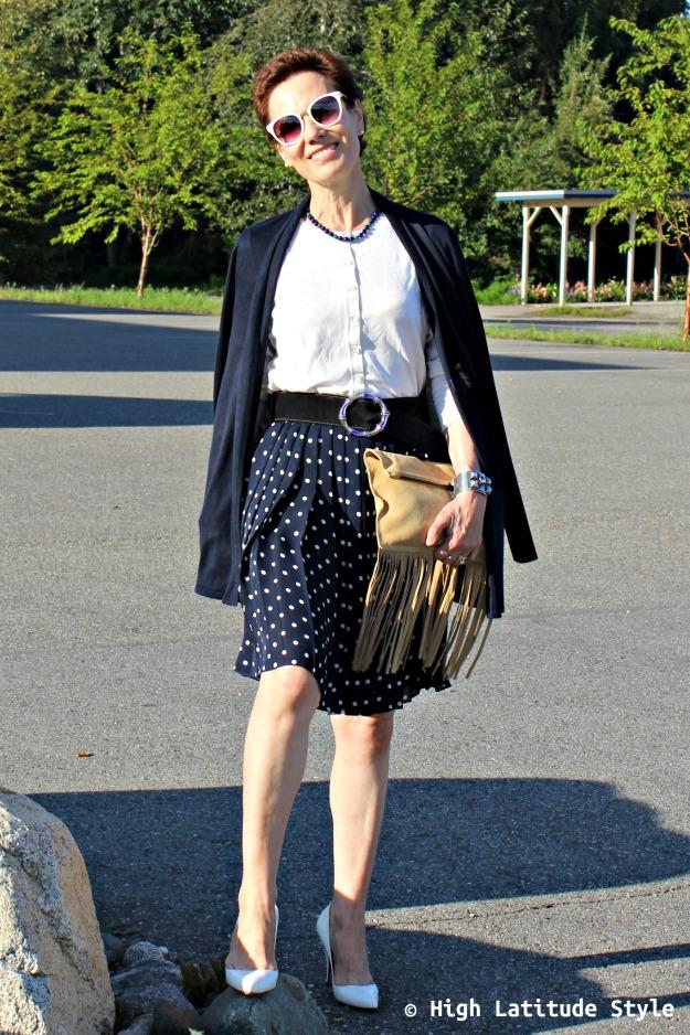 fashion over 50 woman with Uno Alla Volta artisan made clutch