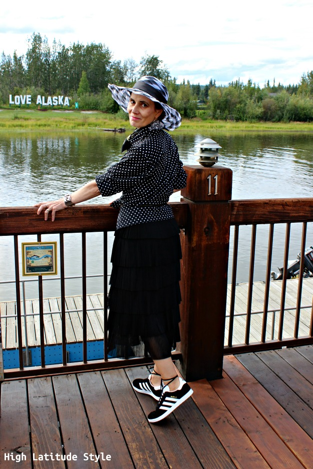 fashion over 50 woman in black and white outfit with hat