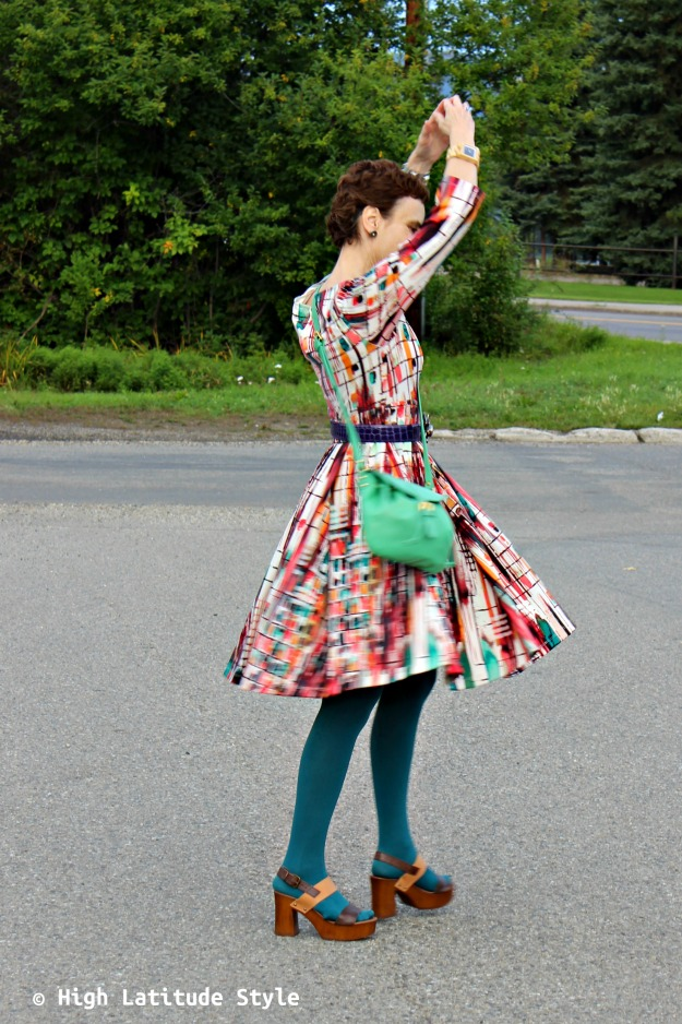fashion over 40 woman in print dress with color crossbody