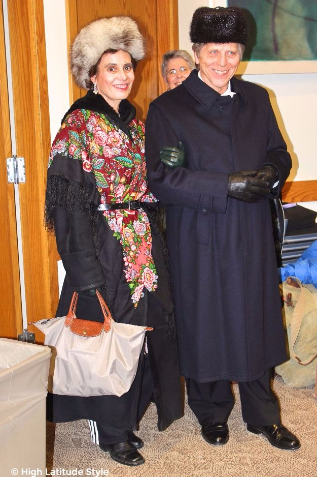 Alaskan couple dressed up in winter gear to attend a formal event