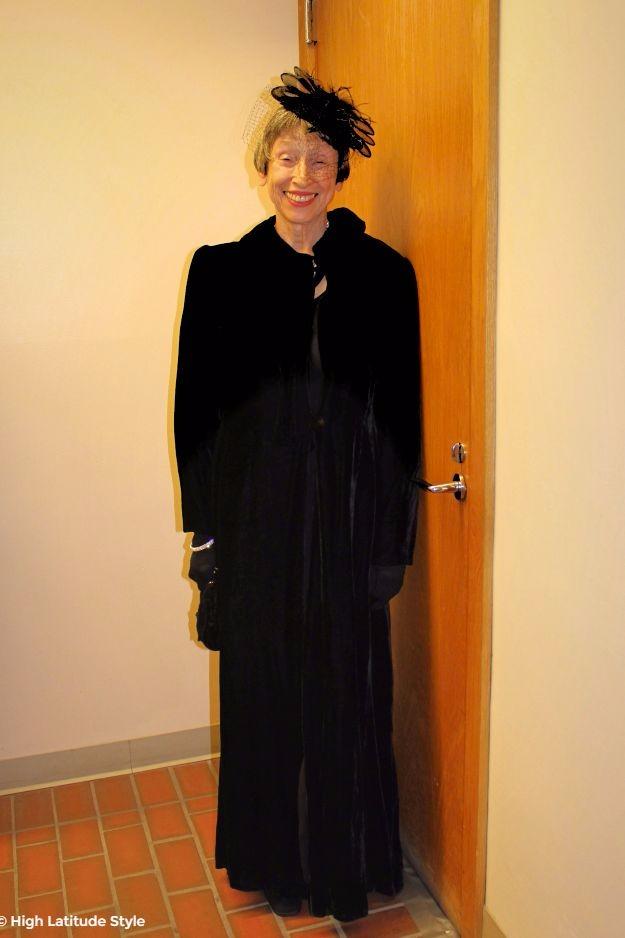 model in long velvet coat with hat from the 50s
