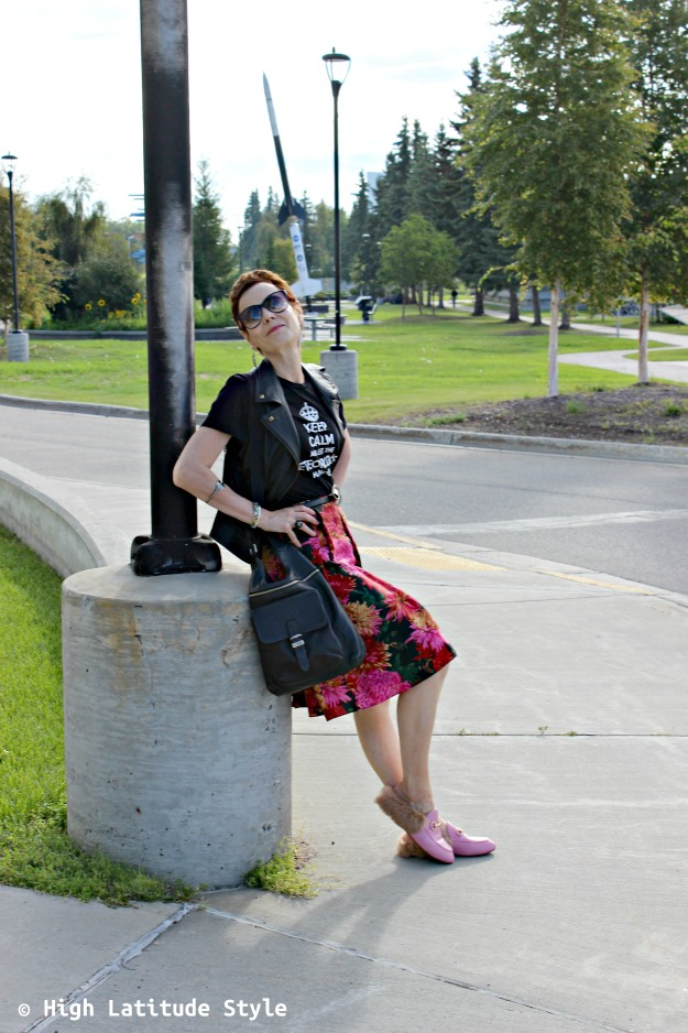 Fashion over 50 woman wearing a summer skirt in fall