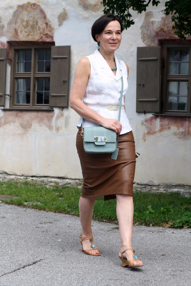 Lady of Style in a tan leather pencil skirt
