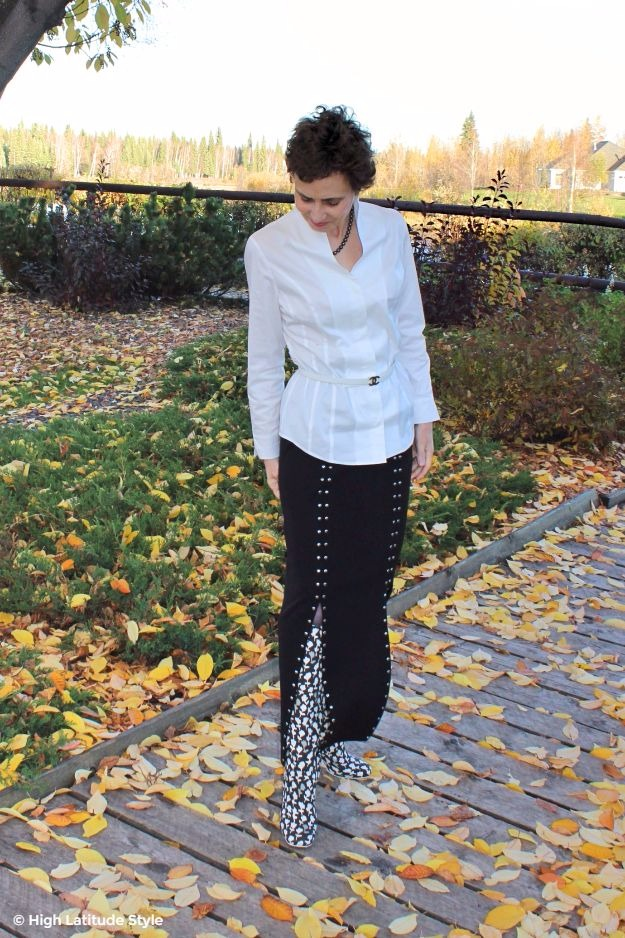 woman in high collar blouse and boot skirt