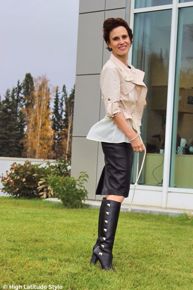 mature woman in studded boots and leather skirt